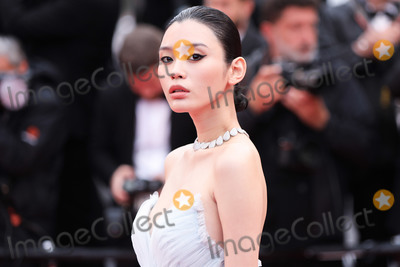 """Ming Xi Photo - CANNES, FRANCE - MAY 18: Ming Xi attends the screening of """"Les Plus Belles Annees D'Une Vie"""" during the 72nd annual Cannes Film Festival on May 18, 2019 in Cannes, France. (Photo by Laurent Koffel/ImageCollect.com)"""