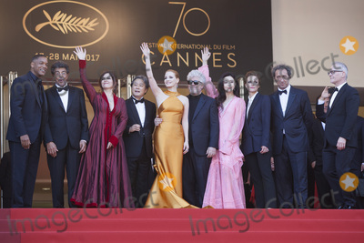 Agnes Jaoui, Fan Bingbing, Jessica Chastain, Maren Ade, Paolo Sorrentino, Park Chan, Park Chan-Wook, Pedro Almodovar, Thierry Fremaux, Will Smith, The Jury, Jessica Paré Photo - CANNES, FRANCE - MAY 23: (L-R) Jury members Will Smith, Gabriel Yared, Agnes Jaoui, Park Chan-wook, Jessica Chastain, President of the jury Pedro Almodovar, jury members Fan Bingbing, Maren Ade, Paolo Sorrentino and Director of the Cannes Film Festival Thierry Fremaux attend the 70th Anniversary of the 70th annual Cannes Film Festival at Palais des Festivals on May 23, 2017 in Cannes, France. (Photo by Laurent Koffel/ImageCollect.com)