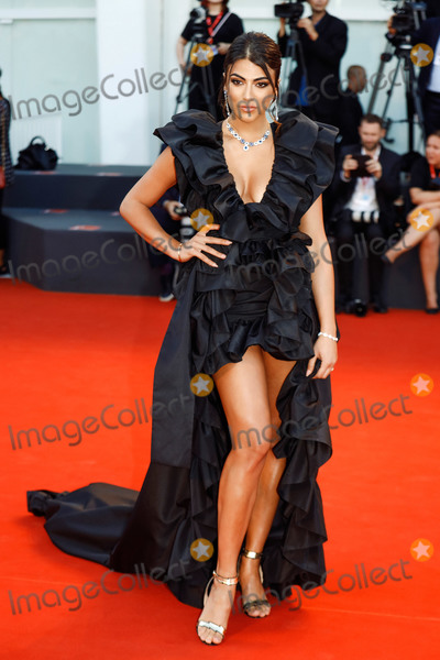 """Photo - VENICE, ITALY - SEPTEMBER 4: Giulia Salemi walks the red carpet ahead of the """"Lan Xin Da Ju Yuan"""" (Saturday Fiction) screening during the 76th Venice Film Festival at Sala Grande on September 04, 2019 in Venice, Italy.(Photo by Laurent Koffel/ImageCollect.com)"""