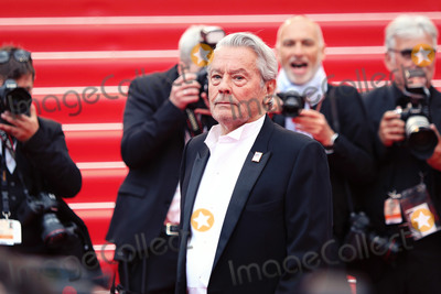 """Alain Delon Photo - CANNES, FRANCE - MAY 19: Alain Delon attends the screening of """"A Hidden Life (Une Vie Cache)"""" during the 72nd annual Cannes Film Festival on May 19, 2019 in Cannes, France.  (Photo by Laurent Koffel/ImageCollect.com)"""