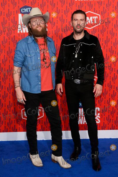 John Osborne, Brothers Osborne Photo - NASHVILLE - JUNE 5: John Osborne (L) and TJ Osborne of the Brothers Osborne attend the 2019 CMT Music Awards at the Bridgestone Arena on June 5, 2019 in Nashville, Tennessee.