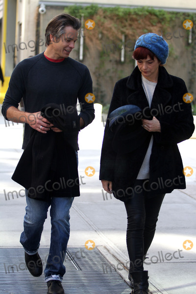 Timothy Olyphant Photo - Actor Timothy Olyphant and his wife Alexis Knief walking in Soho on March 30 2012 in New York City