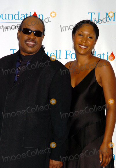 Aisha Morris, Stevie Wonder, TJ Martell, THE HILTONS Photo - Singer Stevie Wonder and his daughter Aisha Morris at the T.J. Martell Foundation Awards Gala at the Hilton Hotel in New York City where Wonder received an award. May 27 2004.