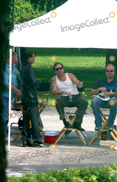 """Jared Leto, Nicolas Cage Photo - Actors Jared Leto and Nicolas Cage relax during a break in filming their new movie """"Lord of War' at The Master's School in Dobbs Ferry, New York. August 2 2004."""