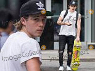 Brooklyn Beckham, David Beckham, David Ellis Photo - EXCLUSIVE:  Brooklyn Beckham tries out his new skateboard in NYC. The 17-year-old was seen assembling his new board on the sidewalk, before joining friends for a ride around the busy streets of Greenwich on Wednesday afternoon. He wore ripped black jeans, a white t-shirt and baseball cap,  The eldest son of former England football captain David Beckham and fashion designer wife, Victoria, has signed up to a photography course at The New School, an arts and design college. Brooklyn has already been used for shoots by fashion house Burberry. Life is looking good for Brooklyn, who dates actress Chloe Grace Moritz, 19, and learned to drive in a  Pounds 37,000 Mercedes C-Class. He also has 7.6 million followers on photo-sharing website Instagram. **PLEASE AGREE FEE BEFORE USAGE** Please contact David Ellis 07967967211 david.ellis3copyrighticloud.com