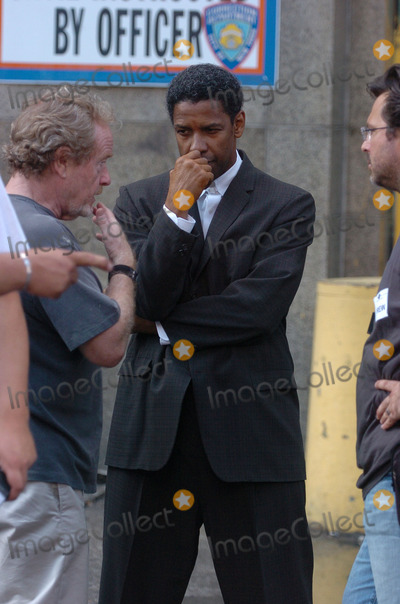 Ridley Scott, Denzel Washington Photo - Denzel Washington and Ridley Scott on the movie set of 'American Gangster'.