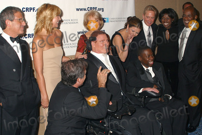 Group Shot, Barbara Walters, Catherine Zeta-Jones, Christopher Reeve, Deborah Roberts, Michael Douglas, Ron Meyer, William Christopher, KIM CATRALL, Robin Williams, AL ROCKER Photo - 12th Annual Magical Birthday Bash to benefit the Christopher Reeve Paralysis Foundation at the Marriott Marquis. Pictured are: (L to R) Ron Meyer, Kim Catrall, Robin Williams, Christopher Reeve, Barbara Walters, Catherine Zeta-Jones and Michael Douglas, Deborah Roberts and husband Al Rocker. New York, September 25, 2002.