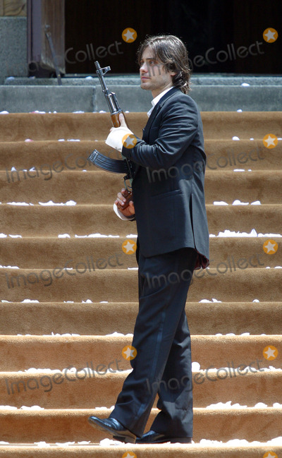 Jared Leto Photo - Actor Jared Leto holding Russian gun AK 47 on the set of 'Lord of War, at Brighton Beach in Brooklyn, New York City. August 3 2004.