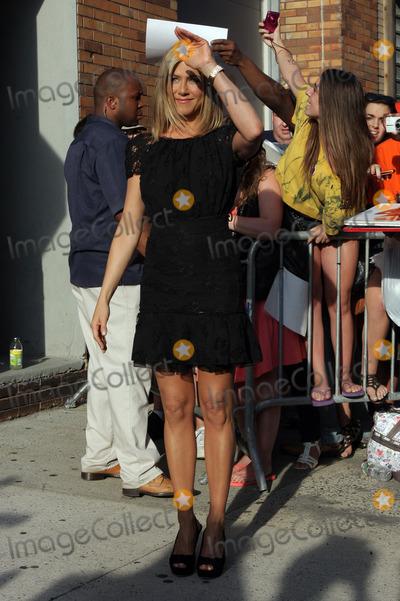 Jennifer Aniston, Jon Stewart Photo - Actress Jennifer Aniston made an appearance at the Daily Show with Jon Stewart on June 27 2011 in New York City