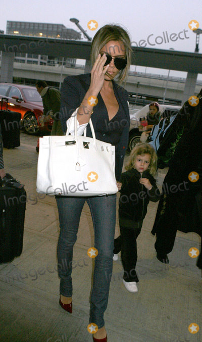 Romeo Beckham, Spice Girl, Spice Girls, Victoria Beckham, JFK, Brooklyn Beckham Photo - Fashion icon and former spice girl Victoria Beckham shephards her son Romeo into JFK Airport enroute to LA.