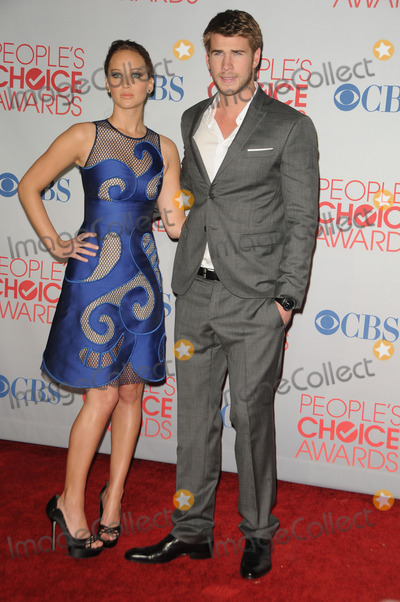 Jennifer Lawrence, Liam Hemsworth Photo - January 11 2012, LA  Actress Jennifer Lawrence and actor Liam Hemsworth in the press room during the People's Choice Awards 2012 at Nokia Theatre LA Live on January 11, 2012 in Los Angeles, California.