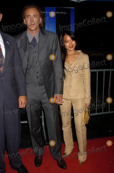 NICHOLAS CAGE, Alice Kim Photo - Nicholas Cage and Alice Kim attend the 'World Trade Center' World Premiere held at the Ziegfeld Theatre.