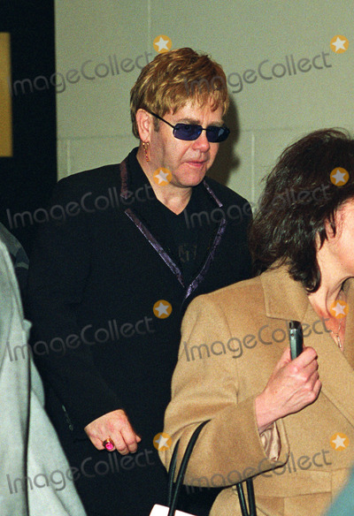 """Elton John Photo - * WORLD SYNDICATION RIGHTS *    Elton John leaving MTV Studios in New York after making an appearance on the """"Total Request Live"""" Show. January 11, 2002.   2002 by Alecsey Boldeskul.  ONE-TIME REPRODUCTION RIGHTS."""