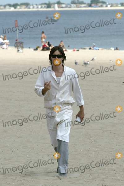 """Jared Leto, Coney Island Photo - Actor Jared Leto returns to Coney Island. Four years ago Leto starred in 'Requiem For a Dream' a drama about a drug addict which unfolded on Coney Island.     Today, Jared Leto returns to film his latest movie, """"Lord of War.""""     Gentleman Leto did a heroic thing while on movie set. Leto resqued a Russian girl from a stalker who followed her from home to the ocean front. Later, Leto approached the girl to find out if she was OK.    Brooklyn, New York, August 7, 2004."""
