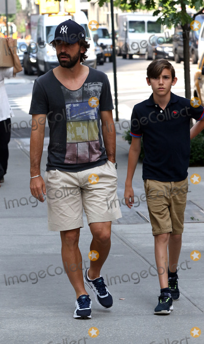 Andrea Pirlo Photo -   June 23 2015, New York City  Italian professional footballer Andrea Pirlo, who plays for Italian club Juventus and the Italian national team, walks with his son Niccol on June 23 2015 in New York City  By Line: Zelig Shaul/ACE Pictures   ACE Pictures, Inc. tel: 646 769 0430