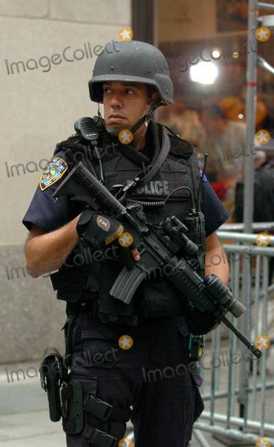 ARMED POLICE Photo - Specialist emergency Police units are being seen more frequently at public performances in New York City to provide increased levels of security. These well-armed cops were in attandance at the NBC Today Show summer concert series in Rockafeller Plaza. New York. May 14 2004.