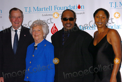 George Bush, Aisha Morris, Barbara Bush, Stevie Wonder, TJ Martell, President George Bush, THE HILTONS Photo - Ex-President George Bush, his wife Barbara, singer Stevie Wonder and his daughter Aisha Morris at the T.J. Martell Foundation Awards Gala at the Hilton Hotel in New York City. George and Barabara Bush, and Stevie Wonder all received awards from the Foundation May 27 2004.
