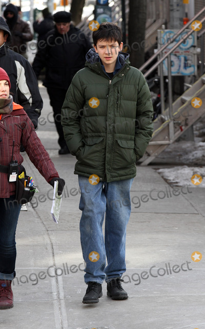 Asa Butterfield Photo - January 28 2014, New York City  Actor Asa Butterfield on the set of the new movie 'Ten Thousand Saints' on January 28 2014 in New York City