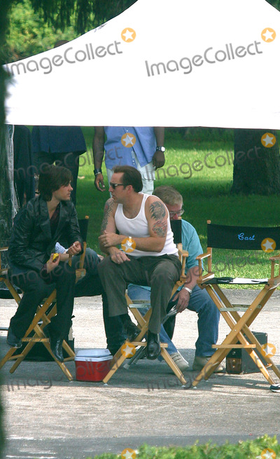 """Jared Leto, Nicolas Cage, Nicolas Cazalé Photo - Actors Jared Leto and Nicolas Cage relax during a break in filming their new movie """"Lord of War' at The Master's School in Dobbs Ferry, New York. August 2 2004."""