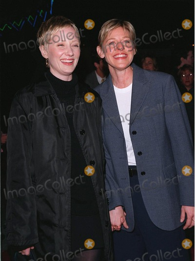 """Anne Heche, Ann Heche Photo - 12MAR98:  Comedienne ELLEN DEGENARES (right) & actress girlfriend ANNE HECHE at the world premiere of """"Primary Colors,"""" in Hollywood."""