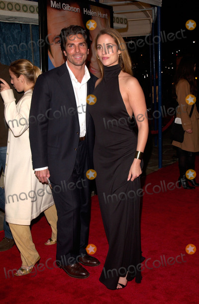 Photo - Actress ELIZABETH BERKELEY & boyfriend at the world premiere, in Los Angeles, of What Women Want.