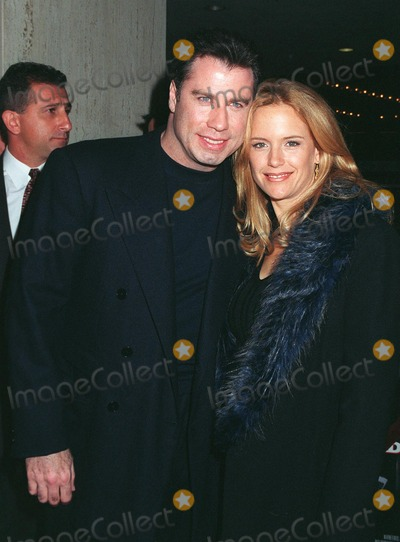 """Dustin Hoffman, John Preston, John Travolta, Kelly Preston, Madness, John Kelly, John  Travolta Photo - 27OCT97:  Actor JOHN TRAVOLTA & actress wife KELLY PRESTON at the premiere in Los Angeles of """"Mad City"""" in which he stars with Dustin Hoffman."""
