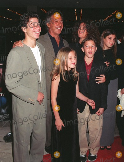 """Dustin Hoffman, John Travolta, Madness, John  Travolta Photo - 27OCT97:  Actor DUSTIN HOFFMAN & wife & children at the premiere in Los Angeles of """"Mad City"""" in which he stars with John Travolta."""