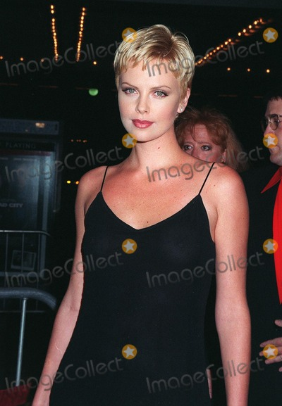 """Charlize Theron, Dustin Hoffman, John Travolta, Madness, John  Travolta Photo - 27OCT97:  Actress CHARLIZE THERON at the premiere in Los Angeles of """"Mad City"""" which stars John Travolta & Dustin Hoffman."""
