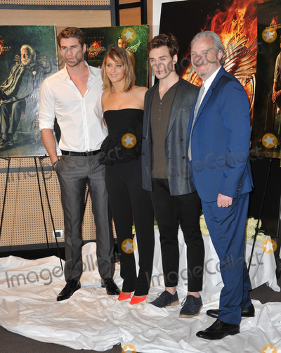 """Francis Lawrence, Jennifer Lawrence, Liam Hemsworth, Sam Claflin Photo - Jennifer Lawrence with Liam Hemsworth & Sam Claflin (right) & director Francis Lawrence at photocall at the 66th Festival de Cannes for their new movie """"The Hunger Games: Catching Fire.""""May 18, 2013  Cannes, FrancePicture: Paul Smith / Featureflash"""