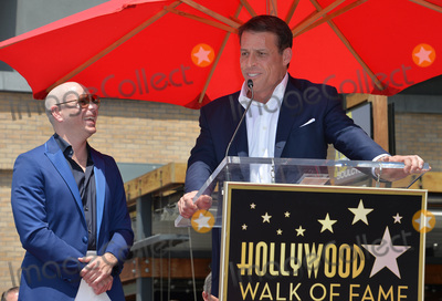 Pitbull, Tony Robbins Photo - LOS ANGELES, CA. July 15, 2016: Singer Pitbull (Armando Christian Perez) with motivational speaker Tony Robbins on Hollywood Blvd where Pitbull was honored with the 2,584th star on the Hollywood Walk of Fame.Picture: Paul Smith / Featureflash