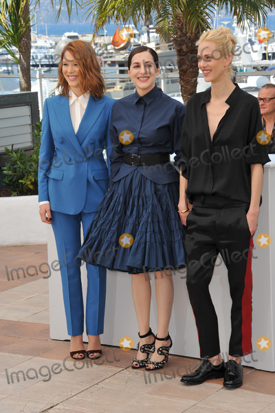 """Amira Casar, Lea Seydoux, Aymeline Valade, Léna Jam-Panoï Photo - Lea Seydoux (left), Amira Casar & Aymeline Valade at photo call for their movie """"Saint-Laurent"""" at the 67th Festival de Cannes.May 17, 2014  Cannes, FrancePicture: Paul Smith / Featureflash"""