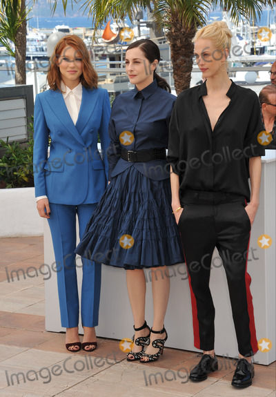 """Amira Casar, Lea Seydoux, Aymeline Valade Photo - Lea Seydoux (left), Amira Casar & Aymeline Valade at photo call for their movie """"Saint-Laurent"""" at the 67th Festival de Cannes.May 17, 2014  Cannes, FrancePicture: Paul Smith / Featureflash"""