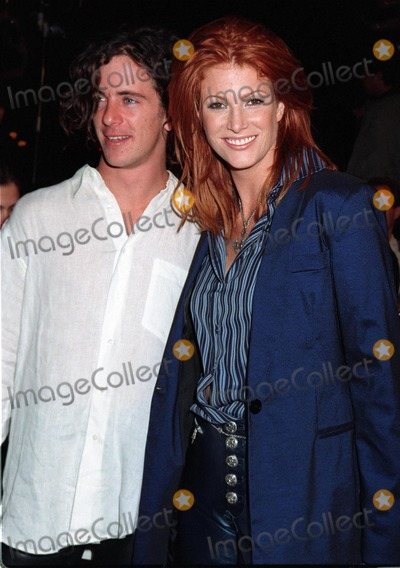 "Angie Everhart Photo - 20NOV97:  Actress ANGIE EVERHART & boyfriend FRITZ PFNUR at premiere of ""Alien Resurrection,"" in Los Angeles."