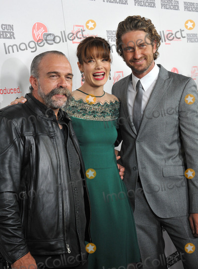 """Gerard Butler, Michelle Monaghan, Sam Childers Photo - Gerard Butler (right), Michelle Monaghan & Sam Childers (upon whom the movie is based) at the Los Angeles premiere of their new movie """"Machine Gun Preacher"""" at the Academy of Motion Picture Arts & Sciences Theatre, Beverly Hills.September 21, 2011  Los Angeles, CAPicture: Paul Smith / Featureflash"""