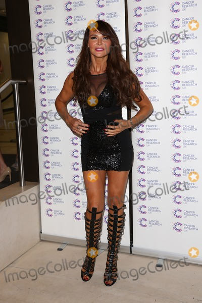 Lizzie Cundy, Lizzy Cundy Photo - Lizzie Cundy arriving at James' Jog On To Cancer Event, Kensington Roof Gardens, London. 09/04/2014 Picture by: Henry Harris / Featureflash