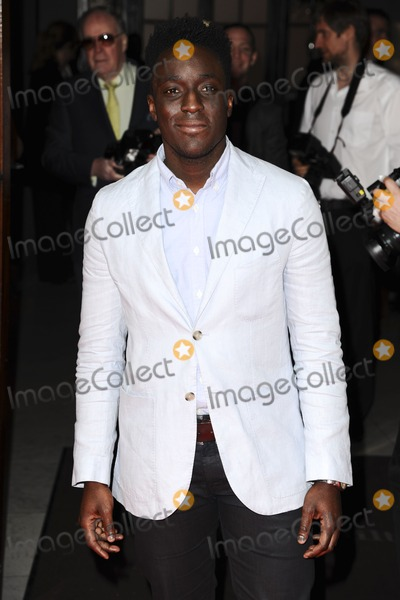 Andy Awkinwolere, Mums Photo - Andy Awkinwolere arrives for the Tesco Mum of the Year Awards 2012 at the Waldorf Hotel, London. 11/03/2012 Picture by: Steve Vas / Featureflash