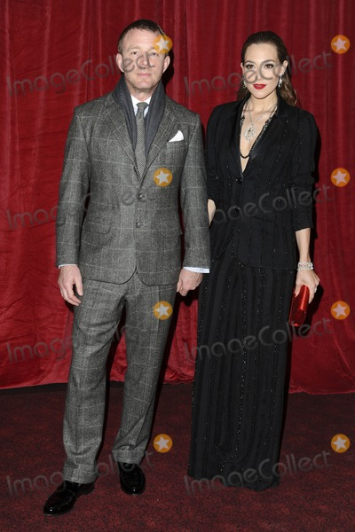 Guy Ritchie, Jacqui Ainsley, Leicester Square Photo - Guy Ritchie and girlfriend, Jacqui Ainsley arriving for the 'Sherlock Holmes: A Game of Shadows' premiere at the Empire Leicester Square, London. 08/12/2011 Picture by: Steve Vas / Featureflash