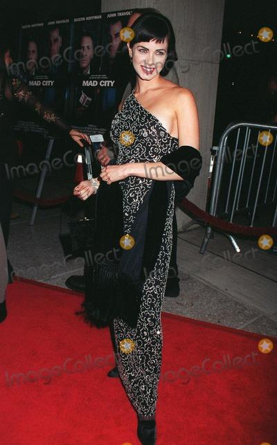 "Dustin Hoffman, John Travolta, Mia Kirshner, Madness, John  Travolta Photo - 27OCT97:  Actress MIA KIRSHNER at the premiere in Los Angeles of ""Mad City"" in which she stars with John Travolta & Dustin Hoffman."