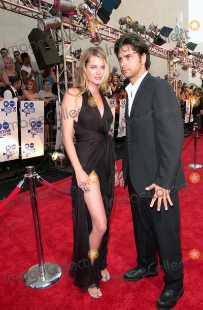 John Stamos, Rebecca Romijn, Rebecca Romijn-Stamos Photo - Model REBECCA ROMIJN-STAMOS & husband JOHN STAMOS at the MTV Movie Awards.