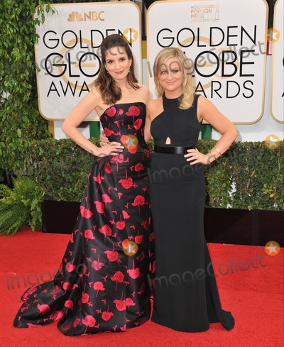 Tina Fey, AMY POHLER Photo - Tina Fey & Amy Pohler (right) at the 71st Annual Golden Globe Awards at the Beverly Hilton Hotel.