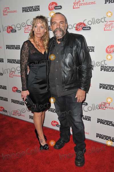 "Sam Childers Photo - Sam Childers (upon whom the movie is based) & wife Linda at the Los Angeles premiere of his new movie ""Machine Gun Preacher"" at the Academy of Motion Picture Arts & Sciences Theatre, Beverly Hills.