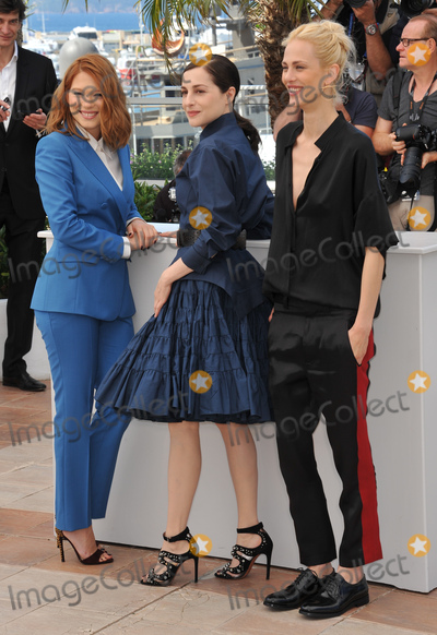 "Amira Casar, Lea Seydoux, Aymeline Valade Photo - Lea Seydoux (left), Amira Casar & Aymeline Valade at photo call for their movie ""Saint-Laurent"" at the 67th Festival de Cannes.