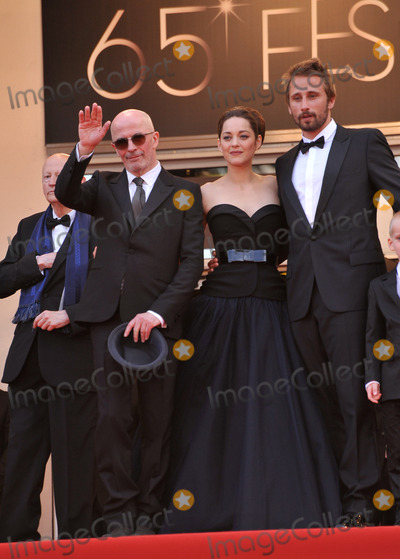 "Jacques Audiard, Marion Cotillard, Matthias Schoenaerts Photo - Actors Matthias Schoenaerts & Marion Cotillard & director Jacques Audiard at the premiere of ""Rust & Bone"" in competition at the 65th Festival de Cannes.