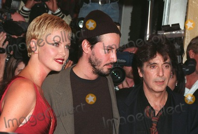 """Al Pacino, Charlize Theron, Keanu Reeves Photo - 13OCT97: Actors AL PACINO (right), KEANU REEVES & CHARLIZE THERON at the world premiere of their new movie, """"Devil's Advocate"""" in Los Angeles."""