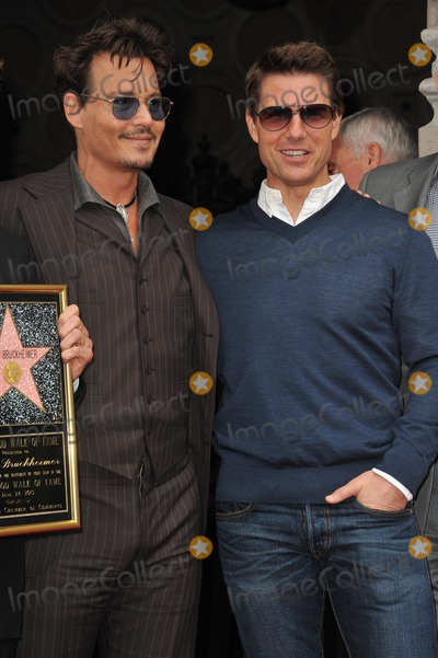 Jerry Bruckheimer, Johnny Depp, Tom Cruise Photo - Johnny Depp & Tom Cruise on Hollywood Blvd where producer Jerry Bruckheimer was honored with the 2,501st star on the Hollywood Walk of Fame. June 24, 2013 Los Angeles, CA Picture: Paul Smith / Featureflash