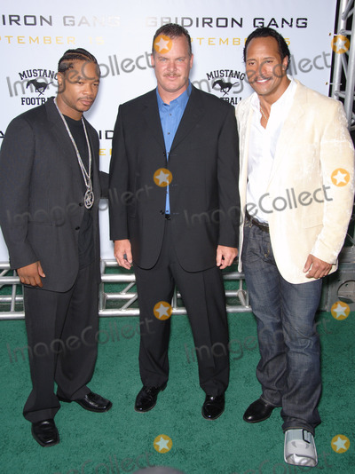 "Alvin ""Xzibit"" Joiner, Alvin 'Xzibit' Joiner, Alvin Joiner, Alvin Xzibit Joiner, Dwayne ""The Rock"" Johnson, Dwayne 'The Rock' Johnson, Dwayne Johnson, Xzibit, THE ROCK, THE JOHNSONS, Grauman's Chinese Theatre Photo - Actors DWAYNE JOHNSON, aka ""The ROCK"", & ALVIN JOINER, aka ""XZIBIT"", with probabtion officer & subject of the movie SEAN PORTER (centre) at the Los Angeles premiere of his new movie ""Gridiron Gang"" at the Grauman's Chinese Theatre, Hollywood.