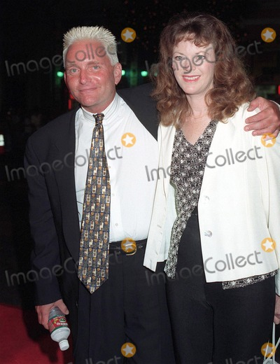 """Eric Douglas, Michael Douglas, Sean Penn, The Game Photo - 08SEP97: Actor ERIC DOUGLAS & girlfriend BARBARA WHINNERY at the premiere of """"The Game,"""" which stars his brother Michael Douglas & Sean Penn. The premiere was at the Chinese Theatre in Hollywood."""
