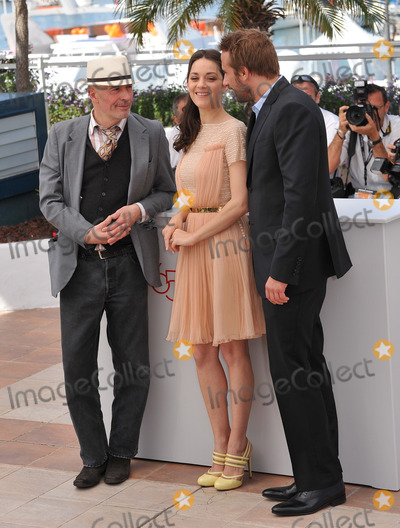 """Jacques Audiard, Marion Cotillard, Matthias Schoenaerts Photo - Marion Cotillard & Matthias Schoenaerts & director Jacques Audiard (left) at photocall for their new movie """"Rust & Bone"""" in competition at the 65th Festival de Cannes.May 17, 2012  Cannes, FrancePicture: Paul Smith / Featureflash"""