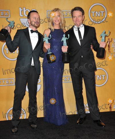 Aaron Paul, Anna Gunn, Bryan Cranston, Anna Maria Perez de Taglé Photo - Bryan Cranston, Anna Gunn & Aaron Paul at the 20th Annual Screen Actors Guild Awards at the Shrine Auditorium.