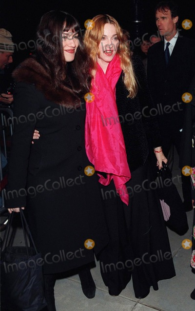 """Bruce Willis, Madonna, Pop Stars Photo - 01APR98:  Pop star/actress MADONNA with MTV presenter JULIETTE HOHNEN at the premiere of Bruce Willis' new movie, """"Mercury Rising,"""" at the Academy Theatre in Beverly Hills."""